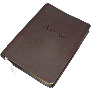 Luxurious leather bound travel atlas book with gilt gold border, circa 1998