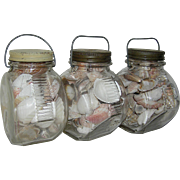 Set of vintage glass containers filled with seashells