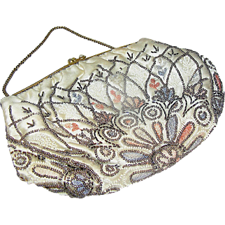 Vintage Women's or Ladies Evening bag or purse with sequins in ivory, pink, and brown.