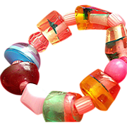 Chunky stretch costurm bracelet of lucite and plastic pieces