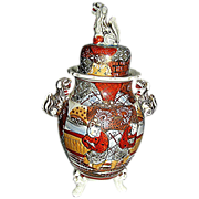 Satsuma covered urn richly decorated in earthen colors from late 19th century