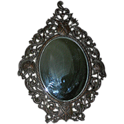 Mirror, beveled, all original set in Spelter, late 19th century