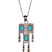 Sarah Coventry Southwest Style Folklore Pendant Necklace 1971 Silvertone Metal w Blue Colored Cabs