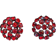 Warner Round Ruby Red Rhinestones Black Metal Clip On Earrings