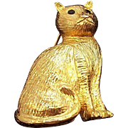 Vintage Textured Goldtone Metal Sitting Cat Pin Rhinestone Eyes
