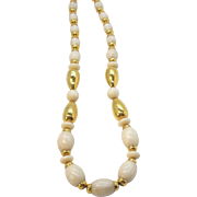 Napier  Oval Shaped Creme Colored Lucite Beads With Goldtone Metal Spacer Beads