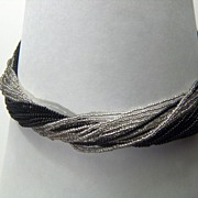 Vintage and GORGEOUS 23 Strand Black & Silver Glass Seed Bead Torsade Necklace