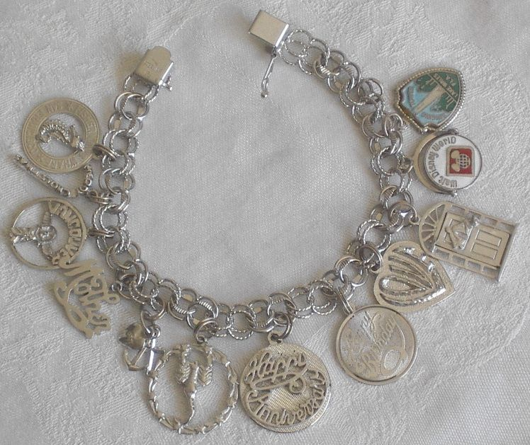 vintage sterling silver charm bracelet with 12 charms