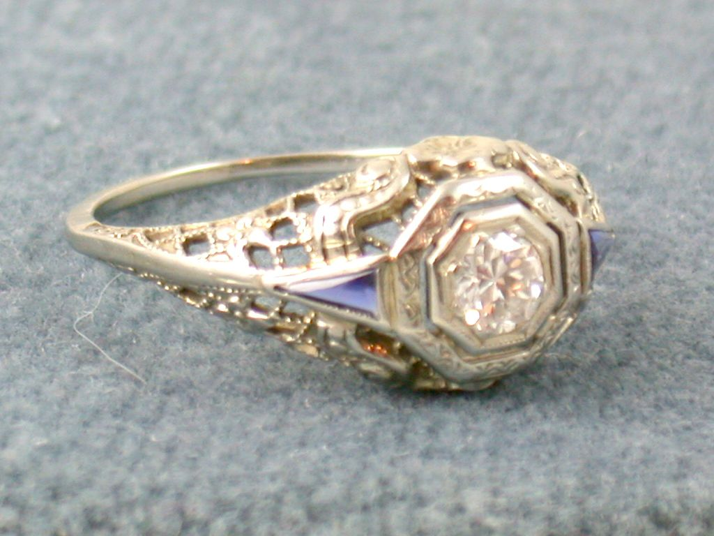 18KW  0 .22 CT Diamond and Blue Stone Filigree Ring