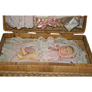1980 Effanbee baby Lisa with factory original layette wicker trunk