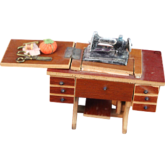 Vintage dollhouse miniature Singer sewing machine with notions