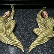Pair of Ceramic Arts Zor and Zorina Wall Plaques