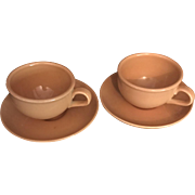 Pair of Cantaloupe Iroquois Cup and Saucer by Russel Wright