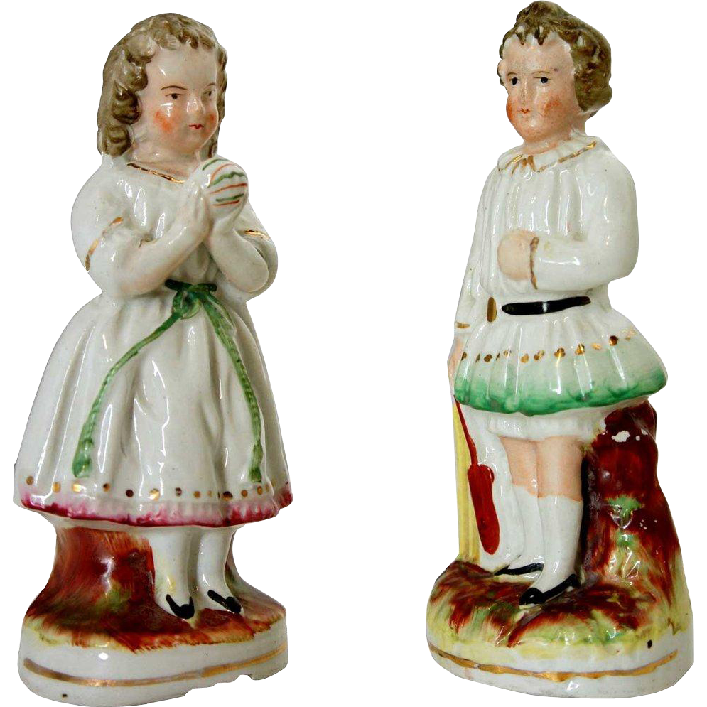 Pair of English Victorian Staffordshire Figures of a Boy and Girl