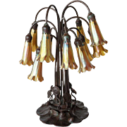 Reproduction Tiffany Studios Bronze and Favrile Glass 12-Light Lily Table Lamp