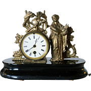 French Neoclassical Gilt Brass and Ebonized Wood Figural Musical Mantel Clock