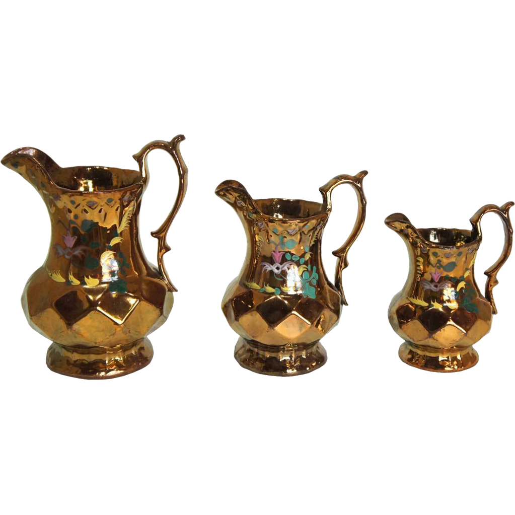 Set of Three English Allerton's Copper Lustre Pottery Graduated Pitchers
