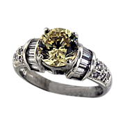 Sterling Ring with a Yellow Centered CZ and Melee