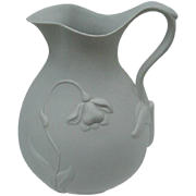 Metropolitan Museum of Art Matte White Ceramic Pitcher with Relief Floral Design
