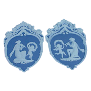 Pair of Shield Shaped Jasperware Plaques, Musicians and Cherubs