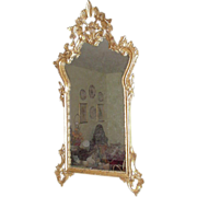 Ornate Gold Leaf Mirror with Basket Design