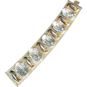 Heavy Gold Tone Bracelet with Flexible Band, Aqua Colored Stones