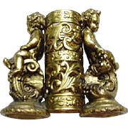 Gold-Tone Metal Lipstick Holder, Cupids and Scrolls