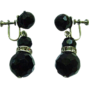Very Vintage Black Faceted Bead Clip Earrings with Channel Mounted Rhinestones Between Beads.