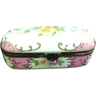 Vintage Porcelain Box with Floral Reserves and Pink Background