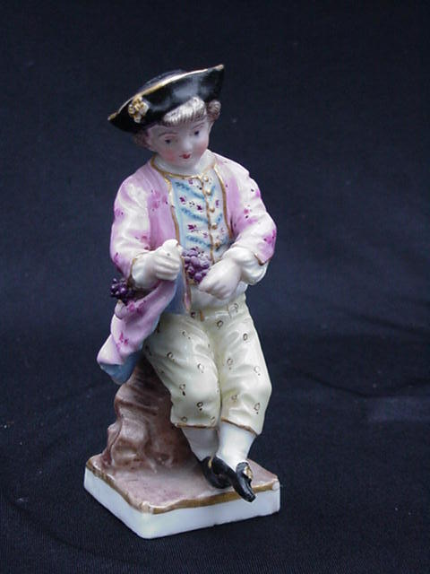 Porcelain Figurine, Small Boy in Waistcoat Gathering Grapes, 19th Century