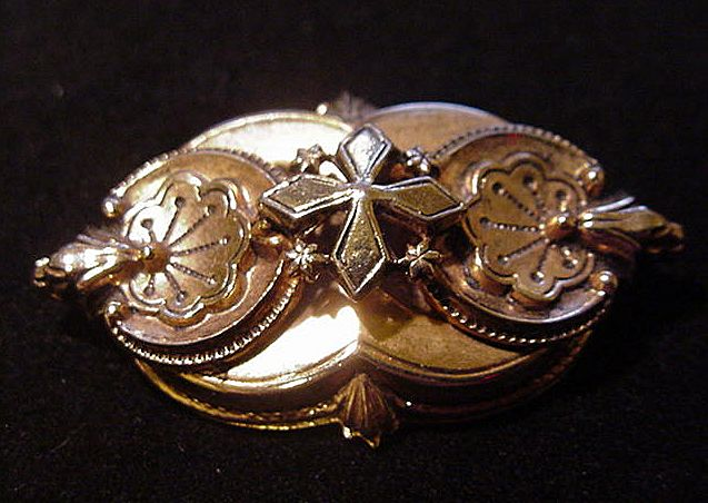 Edwardian Style Pin in Goldtone Metal, Circles, Cross, and Bellflower Decoration