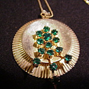 Vintage Gold Tone Metal Necklace, Disk with Prong Mounted Spray of Emerald-Colored Stones