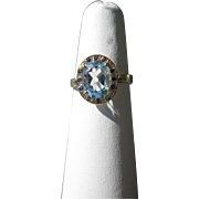 9kt Yellow Gold Sky Blue Topaz with Indigo Blue Sapphires Ladies Ring