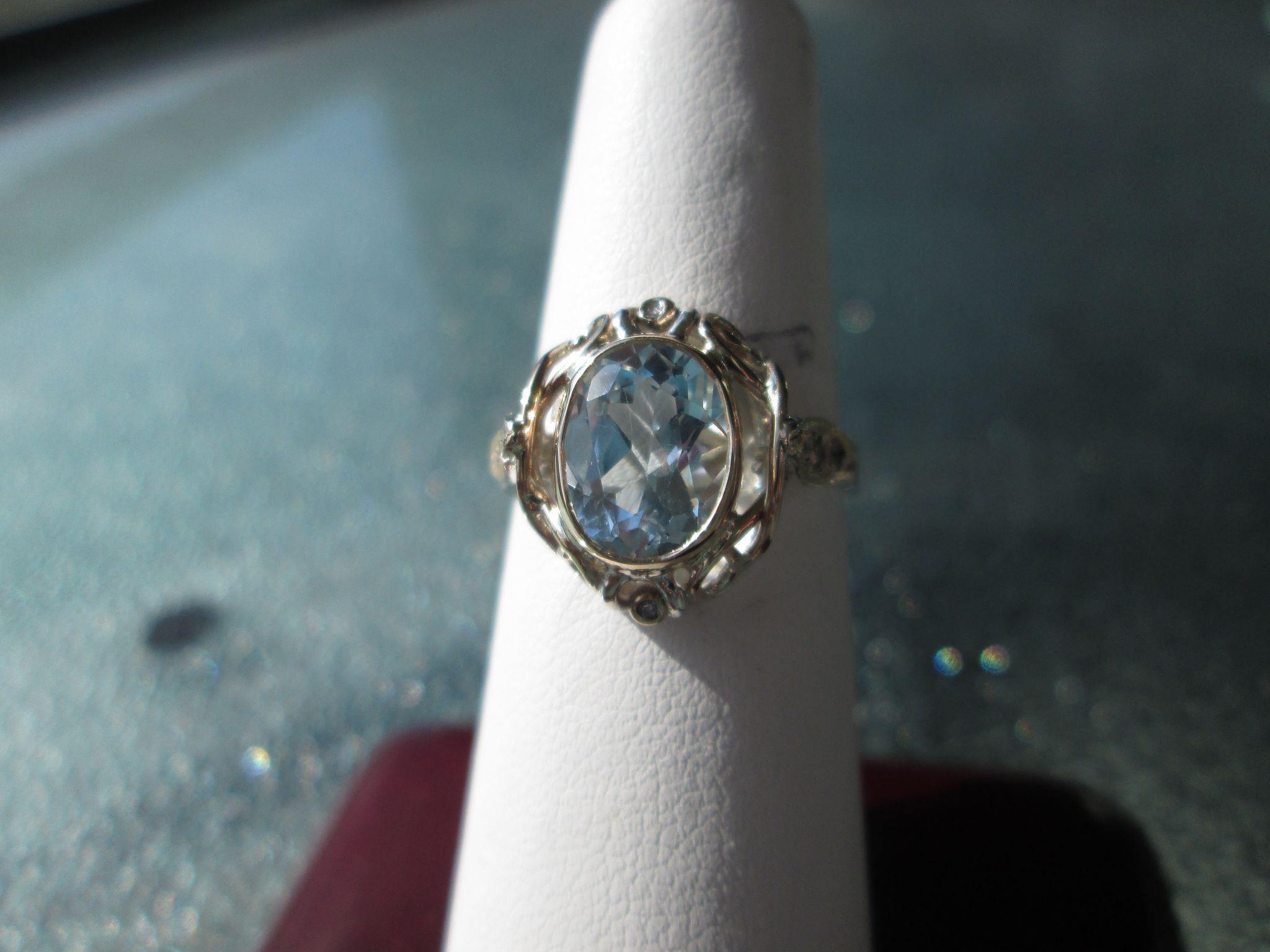 Sterling Silver/9kt Yellow Gold Crystal Clear Oval Blue Topaz and Diamond Ladies RIng
