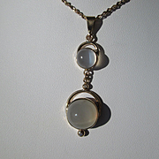9kt Yellow Gold Spectacular Double Round Grey Moonstone and Diamond Dangling Pendant