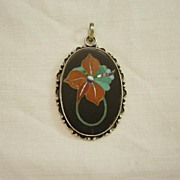 Silver Pendent with Stone Inlay in Black Background