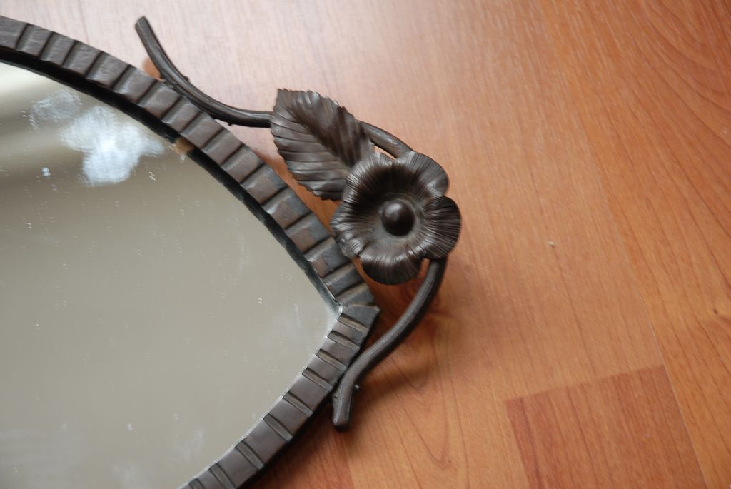 A Rare Art Nouveau Quality Wrought Iron Eye Mirror With Leaf Motif