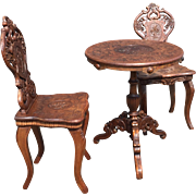 A Black Forest Walnut Hall Set, 2 Chairs with Tripod Table Edelweiss Flowers