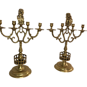 Pair of Bronze Lion Figure Four-Arm Candelabra