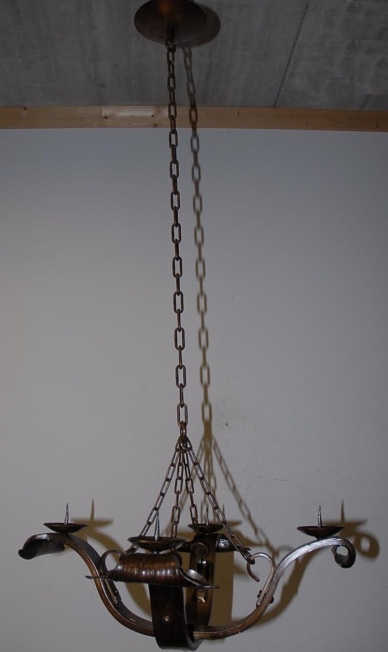 A Vintage wrought Iron Candle Burning Chandelier