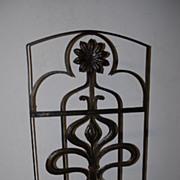An Art Nouveau Wrought Iron Floral Fireplace Screen