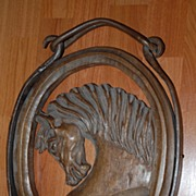 A Carved Wooden Horse Wall Relief in Iron Frame