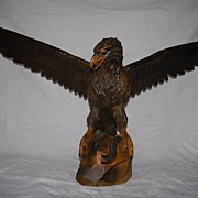 A Fabulous Large Fine Carved Wood Black Forest Eagle Sculpture Standing on a Rock