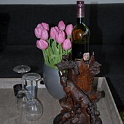 An Antique Carved Wood Black Forest Wine Bottle Caddy / Stand