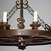 A Wood / Wrought Iron Round 8-light Chandelier