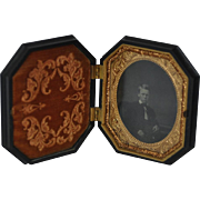 Ambrotype of Young Boy in Highly Carved Octagonal Gutta Percha Union Case by S. Peck Company