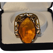 Art Nouveau Large Faceted Marquise Amber Crystal Stone Pin/Brooch Accented with Brass Filigree Design and White Enameled Leaves