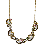 Goldtone Necklace with Scroll and Leaf Design Accented by Faux Pearl Stones and Bright Rhinestones