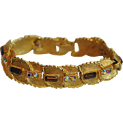 BSK Jewelry Brushed Goldtone Bracelet with Topaz and Aurora Borealis Rhinestones