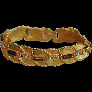 BSK Jewelry Brushed Goldtone Bracelet with Topaz and Aurora Borealis Rhinestones
